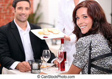 Couple eating in a restaurant