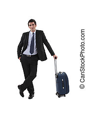 Businessman with luggage stood waiting