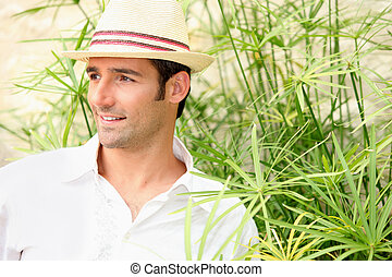 Man surrounded by tall grass