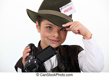 little girl taking a camera and wearing a costume of...