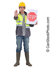 craftsman holding a stop sign