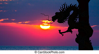 Dragon silhouette and sunset in the sea