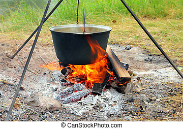 kettle over campfire - camping - kettle over campfire