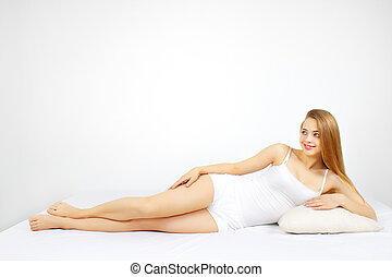 Sexy woman lying on the bed