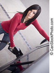 Gas Gouge - A woman fills up and feels the pain in her...