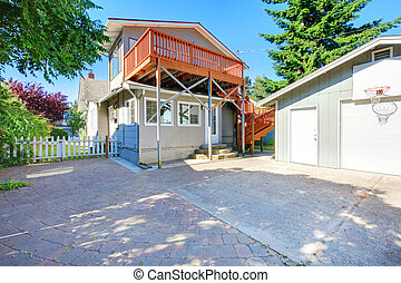 Two story house exterior back yard with garage. - American...