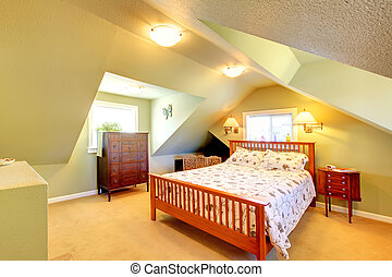 Attic bedroom with green walls and large bed - Cozy attic...