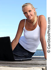 gorgeous blonde on her laptop
