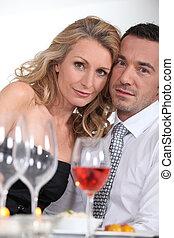 Dressy couple having dinner