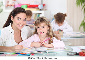 Three little girls in class