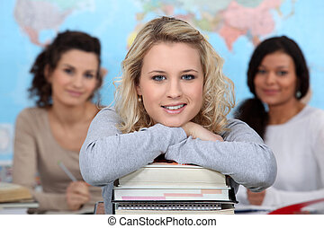 Three teenage girls in class room