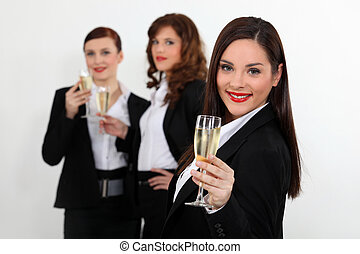Young women in smart suit with glasses of champagne