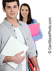Students holding folders