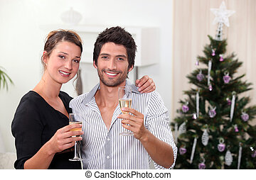 young couple celebrating New Years Eve