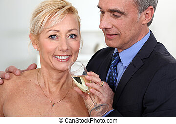 Middle-aged couple drinking champagne