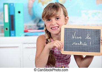 a schoolgirl showing a slate