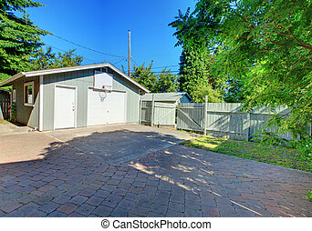 Back yard fenced with garage and paved parking space. -...