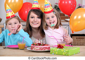 little girls with mom at birthday party