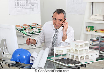 Architect on telephone call