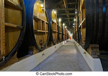 old cellar with wine barrels - old cellar with rows of...