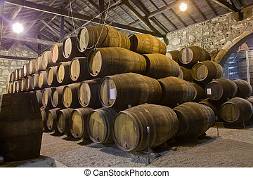 old cellar with wine barrels - path in old cellar with wine...