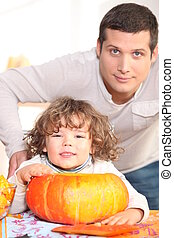young man, kid and pumpkin