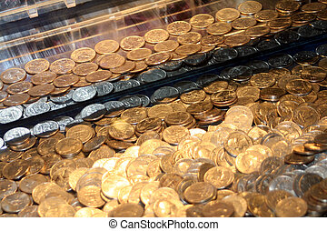 Quarters In An Arcade Game - Angled shot of quarters inside...