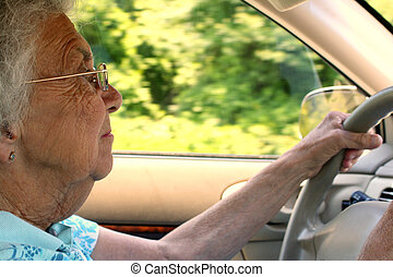 Senior Citizen Woman Driving in Profile - Closeup of a...