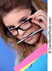 Girl with a pencil in her mouth