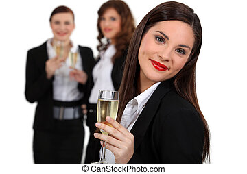 Business women drinking champagne