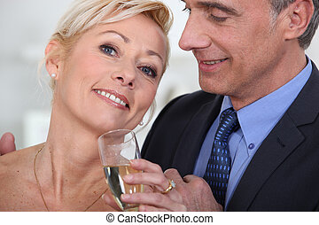 Mature couple drinking champagne