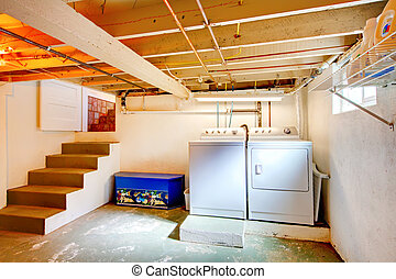 Basement laundry room with old appliances. - Old basement...