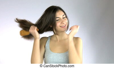 Girl brushing her long hair - Girl brushing her hair happy