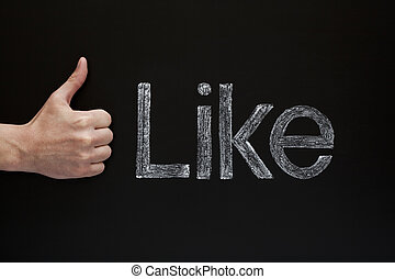 Like - Thumbs up infront of a blackboard with the word Like...