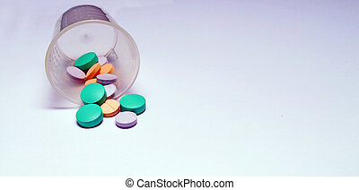 Pills and cup - A cup of pills tipped over