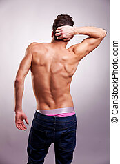 Man with a muscular Back - Back of sexy muscular man on gray...