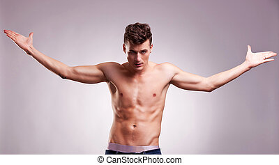 model with his hands in the air - topless young fashion...