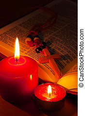 Open Bible with cross and burning candles - Open Bible with...