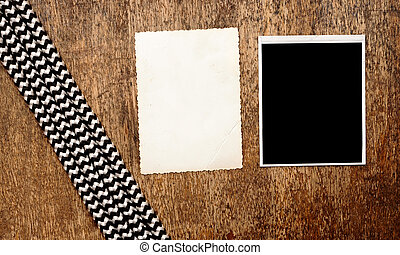 Old photo frames on vintage wood background with rope
