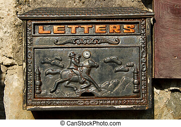 Letter box - A metal letter box with ornate design painted...