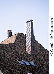 Roof and pipe of a modern apartment house in suburban...