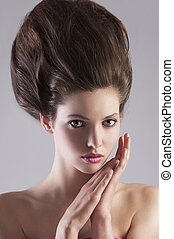 brunette lady with creative hairdo