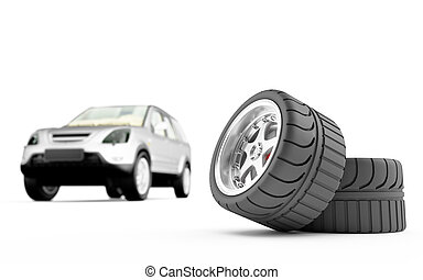 Two automobile wheels on a back background the car