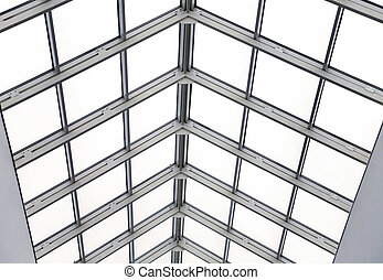 Glass roof with metal frames in an interior of modern office