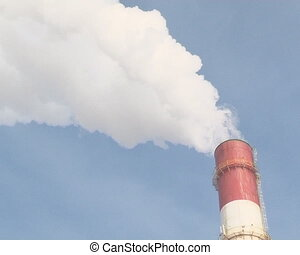 smoke fume chimney heat - Smoke fumes into blue sky from...