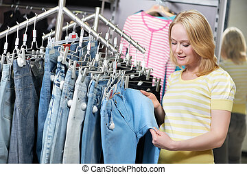 Woman at jeans pants shopping store