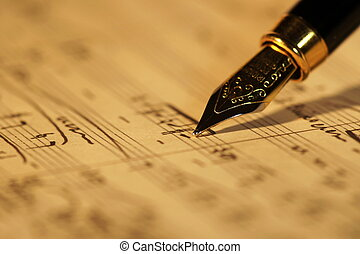 Old sheet music - Selective focus of a fountain pen on top...