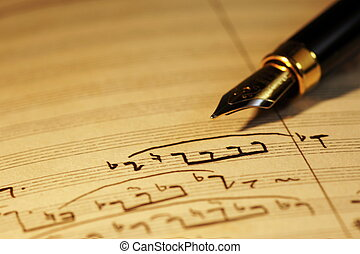 Musical notes - Selective focus of a fountain pen on top of...