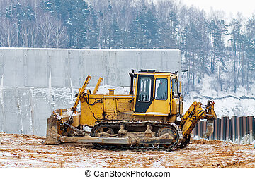 yellow bulldozer working in the winter - bulldozer loader at...