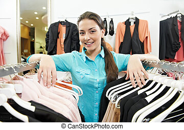 Woman seller consultant in clothes shopping store - Young...